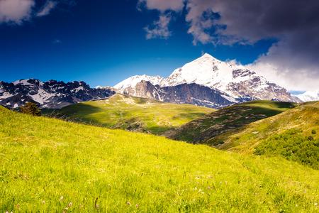 Beautiful view of alpine meadows at the foot of  Tetnuldi glacier. Upper Svaneti, Georgia, Europe. Caucasus mountains. Beauty world. photo