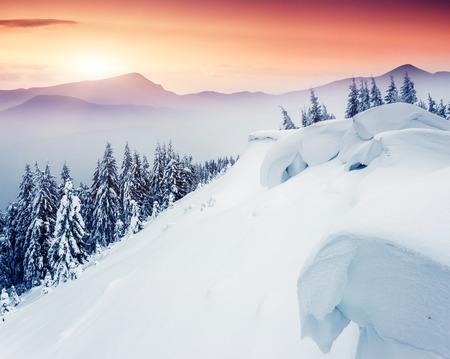 alp: Fantastic evening winter landscape. Dramatic overcast sky. Creative collage. Beauty world.