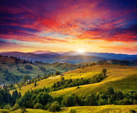 heaven on earth: Beautiful green hills at twilight. Dramatic red sky. Carpathian, Ukraine, Europe. Beauty world. Stock Photo