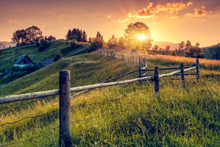 Fantastic morning countryside landscape. Colorful sky. Carpathian, Ukraine, Europe. Beauty world. Stock Photo