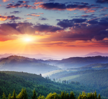 fall sunrise: Majestic sunset in the mountains landscape.Carpathian, Ukraine.