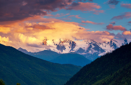 Majestic colorful sunset in the mountains landscape. Upper Svaneti, Georgia, Europe. Caucasus mountains. Beauty world. photo