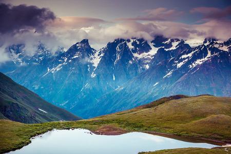 mestia: Fantastic landscape with lake Koruldi and overcast sky at the foot of  Mt. Ushba. Upper Svaneti, Mestia, Georgia, Europe. Caucasus mountains. Beauty world.