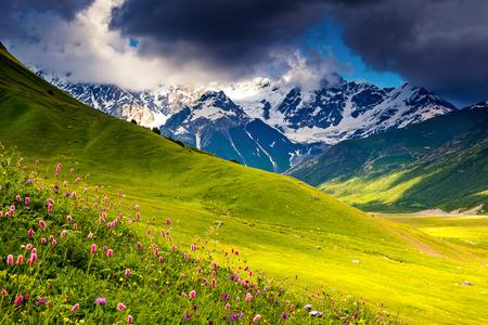 shkhara: Dramatic sky at the foot of  Mt. Shkhara. Upper Svaneti, Georgia, Europe. Caucasus mountains. Beauty world. Stock Photo