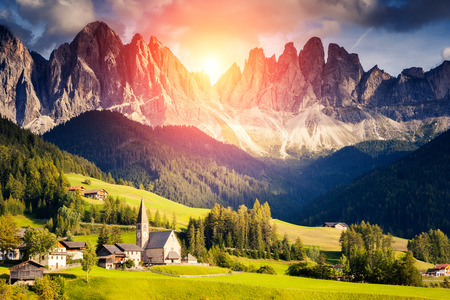 Countryside view of the St. Magdalena or Santa Maddalena in the National Park Puez Odle or Geisler summits. Dolomites, South Tyrol. Location Bolzano, Italy, Europe. Dramatic morning. Beauty world. photo