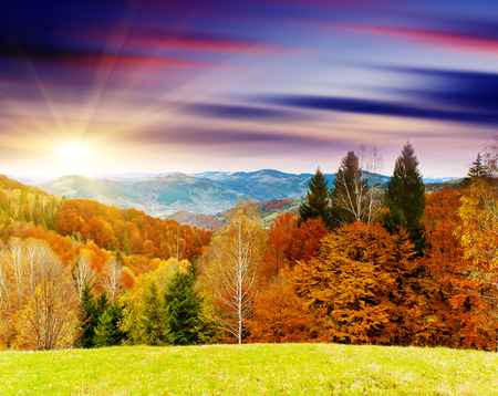 Majestic sunset in the mountains landscape. Dramatic sky. photo
