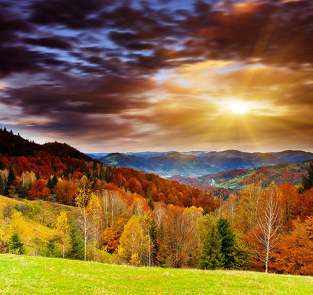 morning sun: Majestic sunset in the mountains landscape. Dramatic sky.