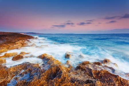 paradise bay: Amazing morning sun over the sea. Volcanic island of Malta. Qawra, Europe. Beauty world. Retro toning effect. Stock Photo