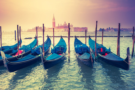 venice: Amazing view of Grand Canal at sunset with San Giorgio Maggiore church. San Marco, Venice, Italy, Europe. Beauty world. Retro style.  Stock Photo