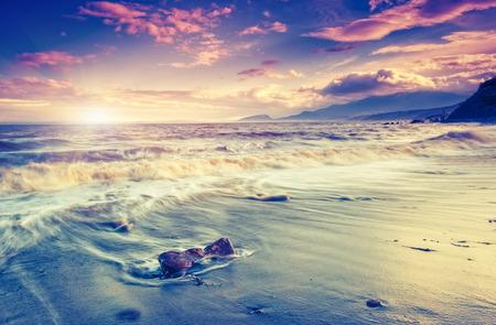 Amazing morning sun over the sea with overcast sky. Black Sea, Crimea, Ukraine, Europe. Beauty world. Retro style filter.  Stock Photo