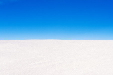snow field: field of snow and beautiful blue sky