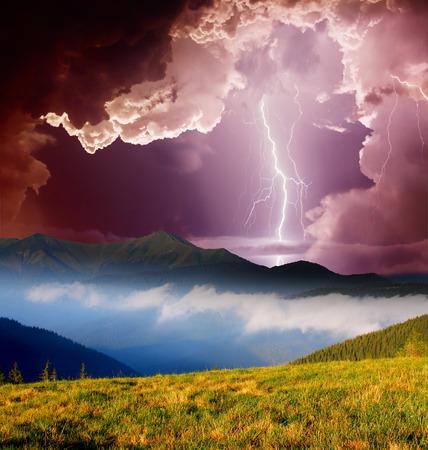 thunderclap: Thunderstorm with lightning in mountain landscape