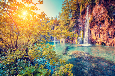 spring landscape: Majestic view on turquoise water and sunny beams in the Plitvice Lakes National Park, Croatia