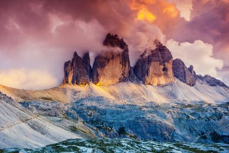 europe: Majestic foggy view of the National Park Tre Cime di Lavaredo with rifugio Locatelli. Dolomites, South Tyrol. Location Auronzo, Italy