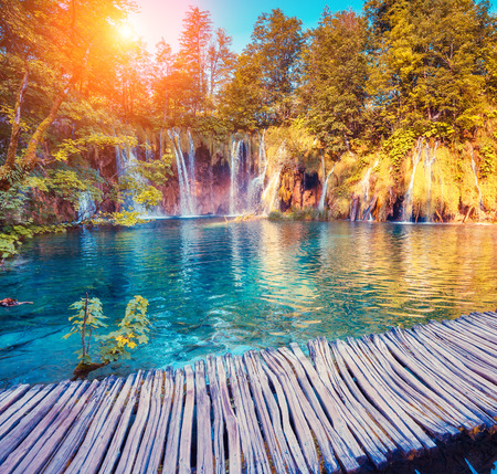 waterfalls: Majestic view on turquoise water and sunny beams in the Plitvice Lakes National Park in Croatia Stock Photo