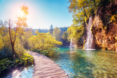 tourism: Majestic view on turquoise water and sunny beams in the Plitvice Lakes National Park, Croatia