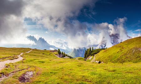 alp: Great view of the Cadini di Misurina range in National Park Tre Cime di Lavaredo. Dolomites, South Tyrol. Location Auronzo, Italy, Europe. Dramatic foggy sky. Beauty world. Stock Photo