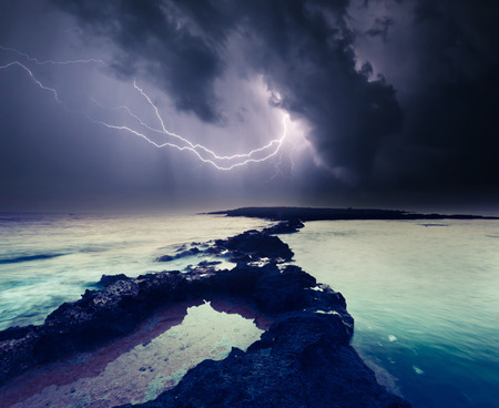 thunderclap: Dark ominous clouds. Thunderstorm with lightning. Volcanic island of Malta. Qawra, Europe. Beauty world.
