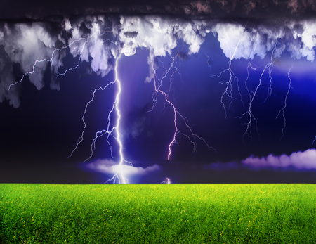 sky and grass: Thunderstorm with lightning in green meadow. Dramatic sky.