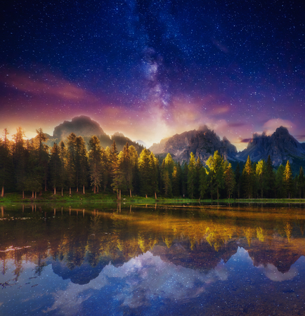 Lago Di Antorno in Natural park Tre Cime di Lavaredo under starry light. Cadini di Misurina Range, Dolomites, South Tyrol. Location Auronzo, Italy, Europe. Astrophotography. Beauty world. Stock Photo