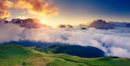 sella: Great view of the foggy Val di Fassa valley with pass Sella. National Park. Dolomites (Dolomiti), South Tyrol. Location Canazei, Campitello, Mazzin. Italy, Europe. Dramatic scene. Beauty world.