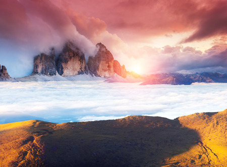 odle: Great view of the foggy Val Gardena valley. National Park Odle – Geisler. Dolomites, South Tyrol. Location Ortisei, S. Cristina and Selva Gardena. Italy, Europe. Dramatic scene. Beauty world.