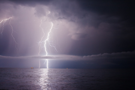 thunderclap: summer storm beginning with lightning Stock Photo