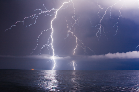 storms: summer storm beginning with lightning Stock Photo