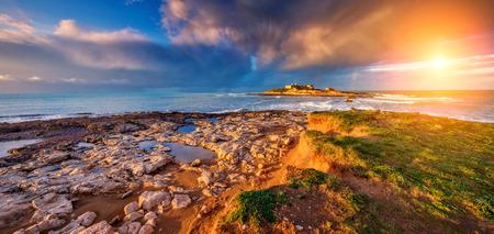 sicilia: Fantastic view of the Isola delle Correnti. Located on cape Passero. Dramatic morning scene in Sicilia, Italy Stock Photo