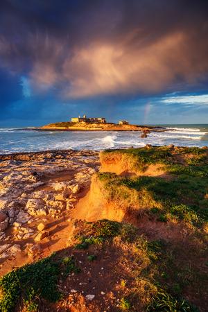 fantastic view: Fantastic view of the Isola delle Correnti. Located on cape Passero. Dramatic morning scene in Sicilia, Italy Stock Photo