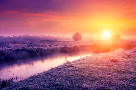 wonderful: Majestic foggy river with fresh green grass in the sunlight. Dramatic colorful scenery in Dnister river, Ternopil. Ukraine Stock Photo