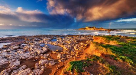 sicilia: Fantastic view of the Isola delle Correnti. Located on cape Passero in Sicilia, Italy Stock Photo