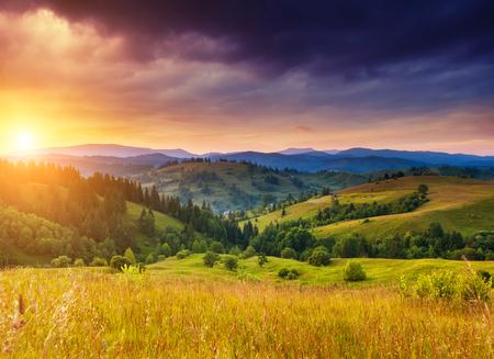 wonderful: Beautiful green hills glowing by warm sunlight at twilight. Dramatic scene. Colorful sky, red clouds. Carpathian, Ukraine, Europe. Beauty world.