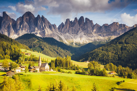 odle: Countryside view of the Funes valley St. Magdalena or Santa Maddalena in the National park Puez Odle or Geisler. Dolomites, South Tyrol. Bolzano, Italy