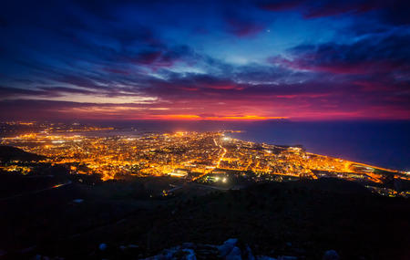 erice: Fantastic aerial view of city illuminated with lights. Dramatic and picturesque scene. Location Trapani, Erice, Sicilia, Italy Stock Photo