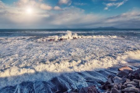 sicilia: Fantastic sea view with blue sky and strong storm waves. Dramatic and picturesque scene. Gioiosa Marea. Lipari island, Sicilia, Italy