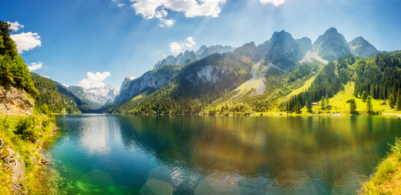 Fantastic azure alpine lake Vorderer Gosausee. Unusual and picturesque scene. Salzkammergut is a famous resort area located in the Gosau Valley in Upper Austria.