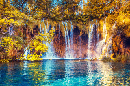 Majestic view on turquoise water and sunny beams. Plitvice Lakes National Park, Croatia