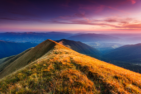 gloaming: A great view of the hills glowing by sunlight at twilight. Dramatic and picturesque morning scene. Carpathian, Ukraine Stock Photo