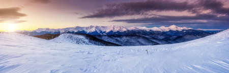 majestic mountain: Majestic mountain glowing by sunlight. Dramatic and picturesque morning wintry scene. Carpathian national park, Ukraine Stock Photo