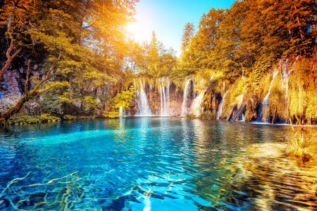 Majestic view on turquoise water and sunny beams. Location famous resort Plitvice Lakes National Park, Croatia