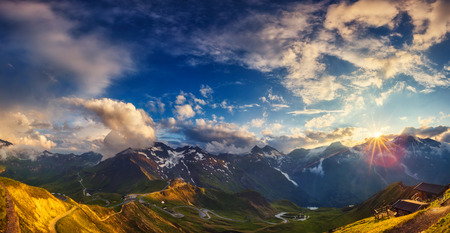 A great view of the hills glowing by sunlight at twilight. Dramatic and picturesque morning scene. Location famous Grossglockner High Alpine Road, Austria. Europe. Artistic picture. Beauty world.