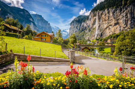 Majestic view of alpine village glowing by sunlight. Picturesque and gorgeous scene. Location famous place Swiss alps, Lauterbrunnen valley, Staubbach waterfall, Europe. Artistic picture. Beauty world Stock Photo