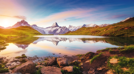Great view of Mt. Schreckhorn and Wetterhorn above Bachalpsee lake . Dramatic and picturesque scene. Location place Swiss alps, Bernese Oberland, Grindelwald, Europe. Soft filter effect. Beauty world. Foto de archivo