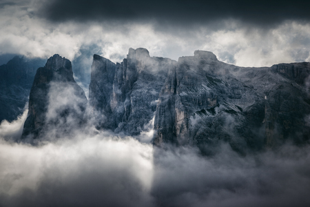 Great view of the foggy valley. Clouds covered the mountain range. Dramatic scene. Location: National Park Tre Cime di Lavaredo, Locatelli. Dolomites Alps, South Tyrol. Italy, Europe. Beauty world.