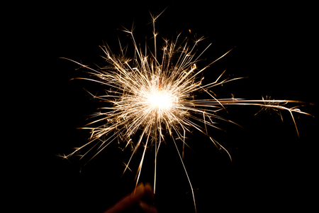 pyrotechnics: christmas sparkler firework flame on black Stock Photo