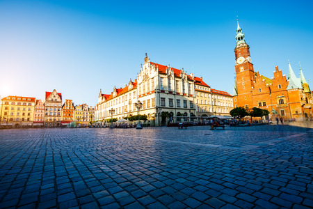 Fantastic view of the ancient homes on a sunny day. Gorgeous picture and picturesque scene. Location famous Market Square in Wroclaw, Poland, Europe. Historical capital of Silesia. Beauty world. Stock Photo