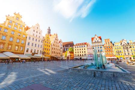 Fantastic view of the ancient homes on a sunny day. Gorgeous and picturesque scene. Location famous Market Square in Wroclaw, Poland, Europe. Historical capital of Silesia. Beauty world. Soft filter.
