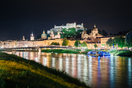 Great view on an evening city shining in the lights. Dramatic picture, picturesque scene. Location famous place (unesco heritage) Festung Hohensalzburg, Salzburger Land, Austria, Europe. Beauty world Stock Photo