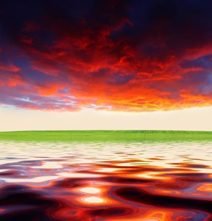 Beautiful colorful sunset at coast of the sea